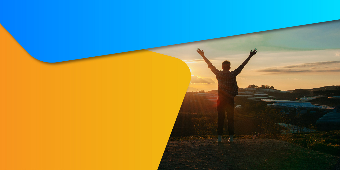 Image of youth raising hands looking into sunset